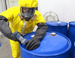 Worker opening chemicals