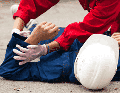 Worker attending to injured colleague