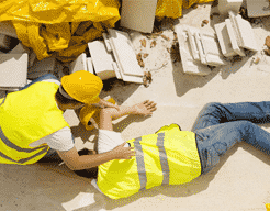 Worker injured on floor receiving treatment