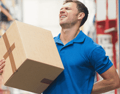 Man holding back while lifting box
