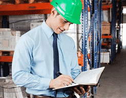 Worker completing health and safety book